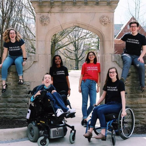 "0b4602c72417 A group of university students wear their ""The Future is Accessible"" shirts."