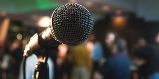 Host a karaoke night as one of our top fundraising event ideas.