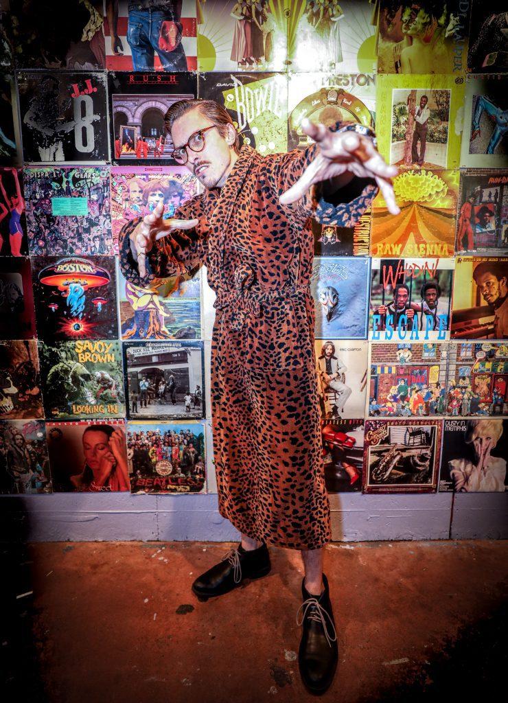 Marc Rebillet in a cheeta robe