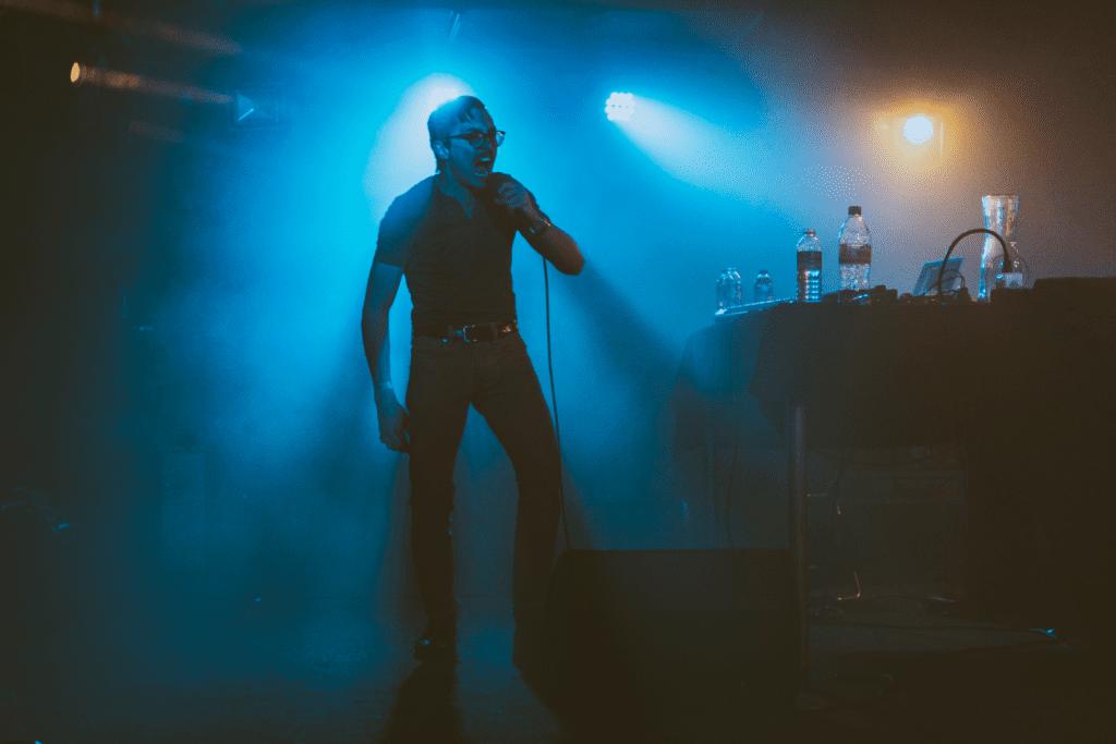 Marc Rebillet on stage singing