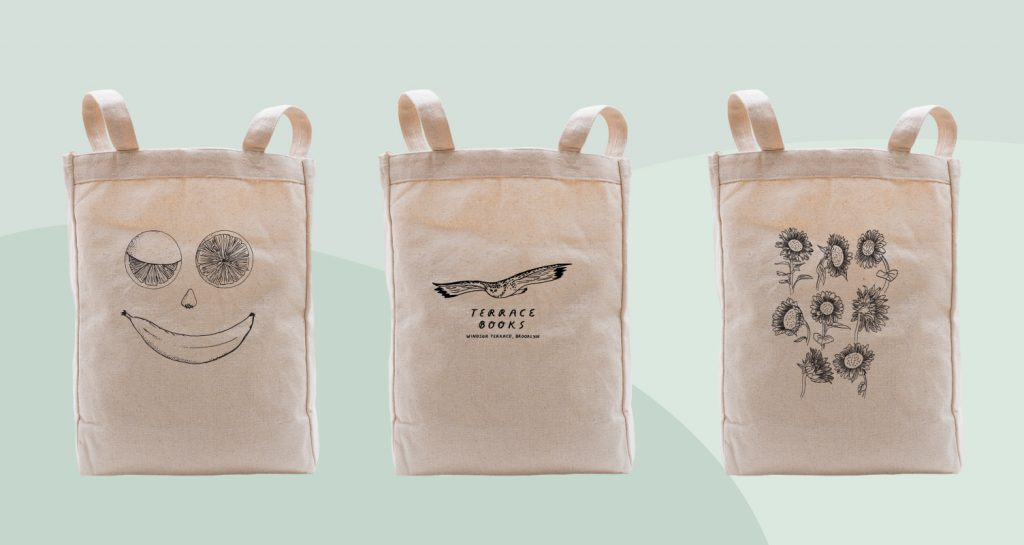 Natural color tote bags that use black ink on their design.