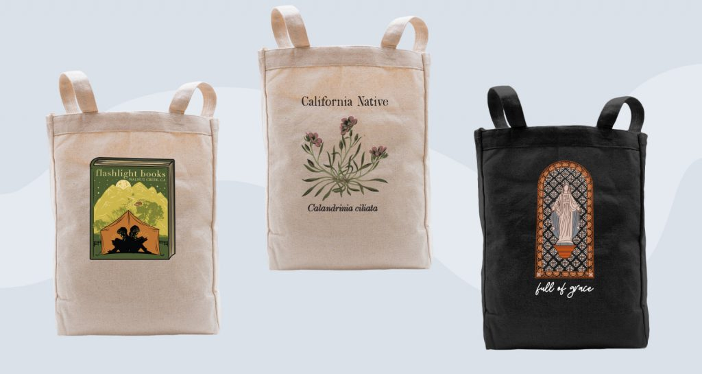 Tote bags with intricate illustrations.