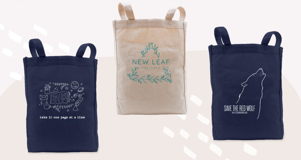 Tote bags with minimalist and thin linework designs.