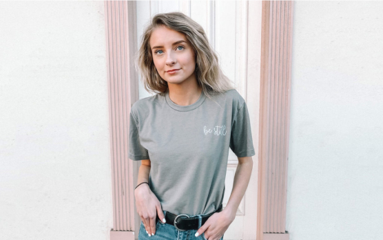 A girl wearing the premium unisex t-shirt, which is the most popular t-shirt style.