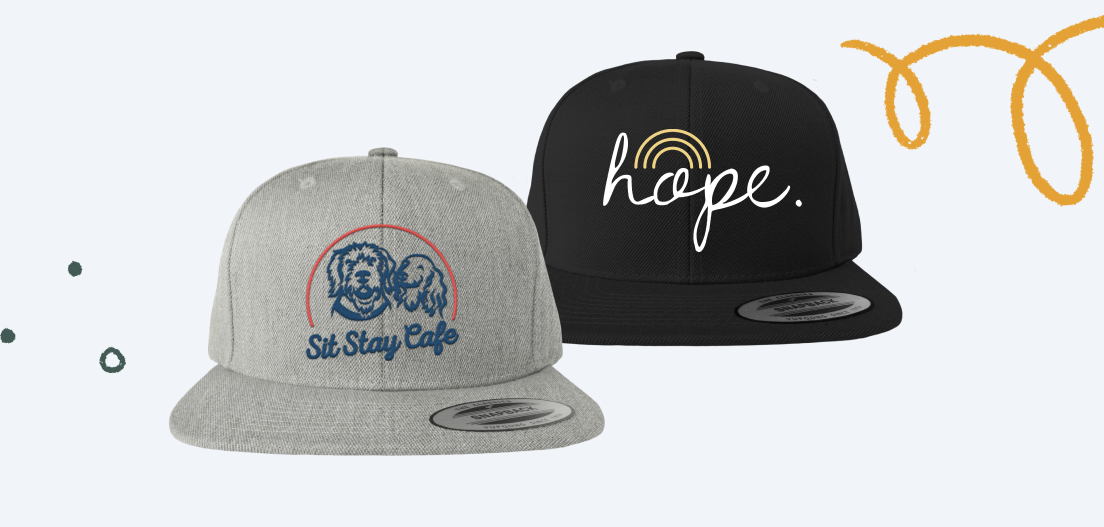 Snapback hat designs from the Trailmixer 2021 - The Lost Coast Snapback Hat, and Hope at the end of the Rainbow (Hat) campaigns.